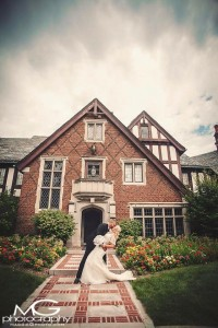 A perfect kiss captured for the happy couple at the Rollins Mansion, Des Moines